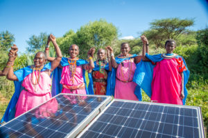 Women in Kenya with solar panels