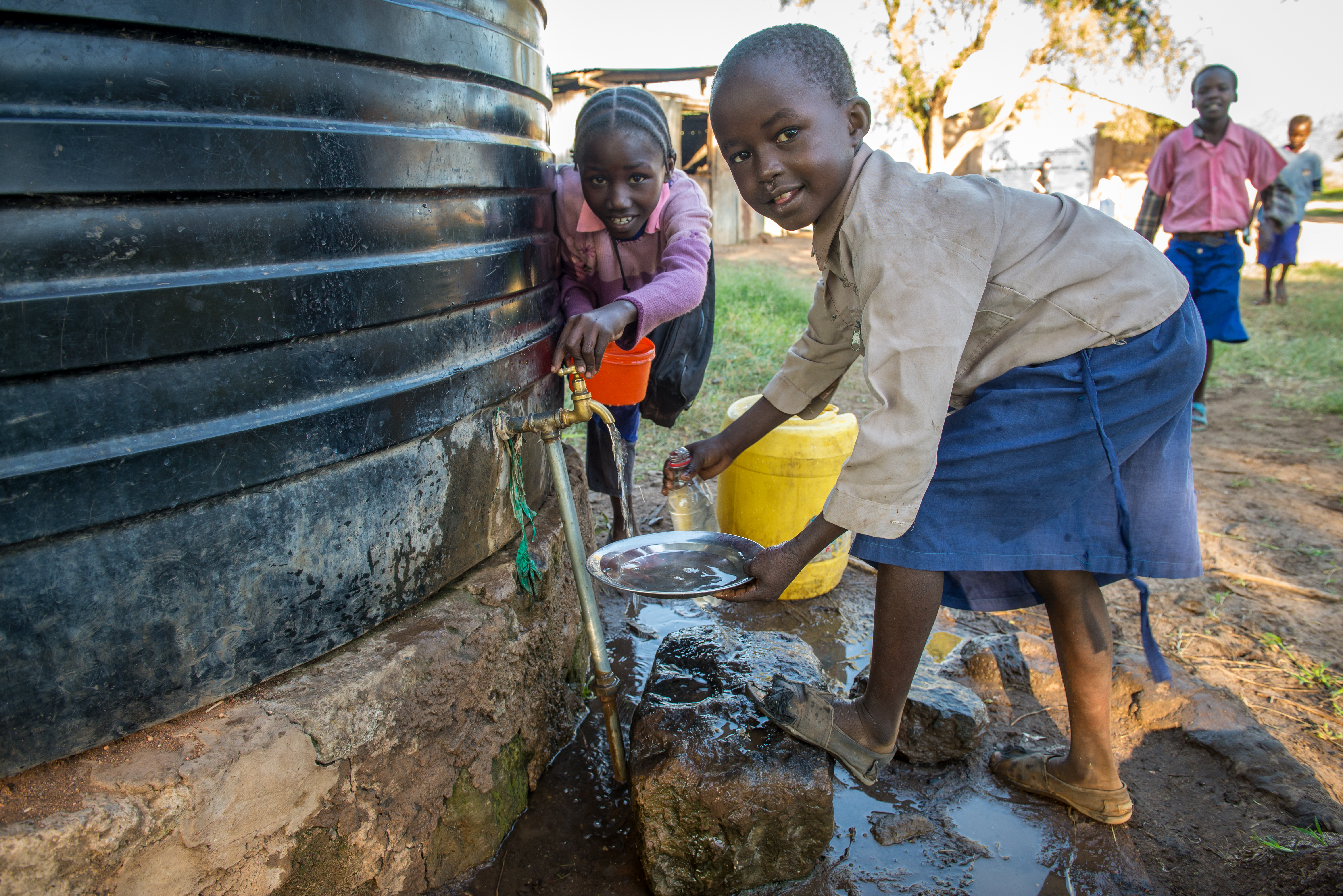 Girls collecting water at a school in Kenya