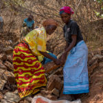 Carrying rocks to build the new dams