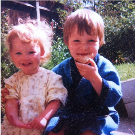 Ellie Wilcock as a child with her brother