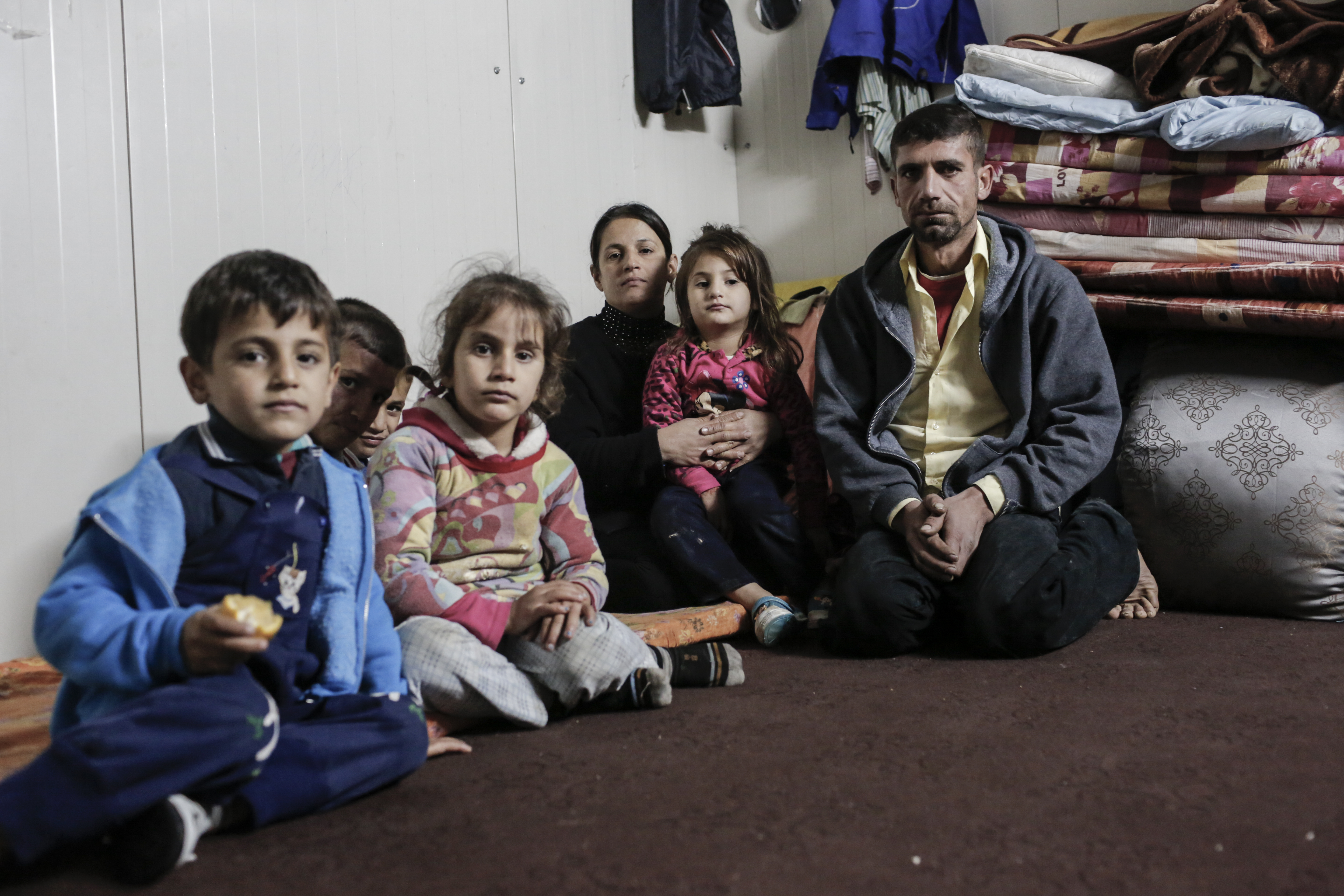 An Iraqi family who have been forced from their home by fighting, who now receive support from CAFOD's partner.
