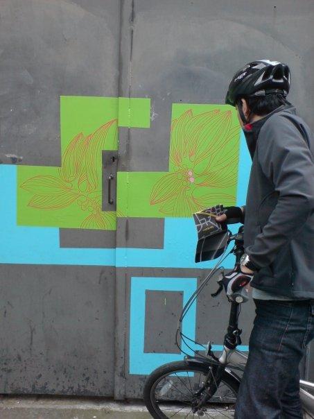 Ivan appreciating artwork on his bike