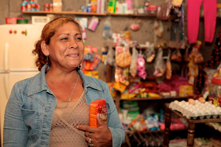 With CAFOD's help Justina has set up a small business and an adult literacy class to help her neighbours