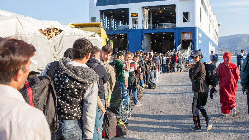 Refugees queuing for the ferry on Lesbos