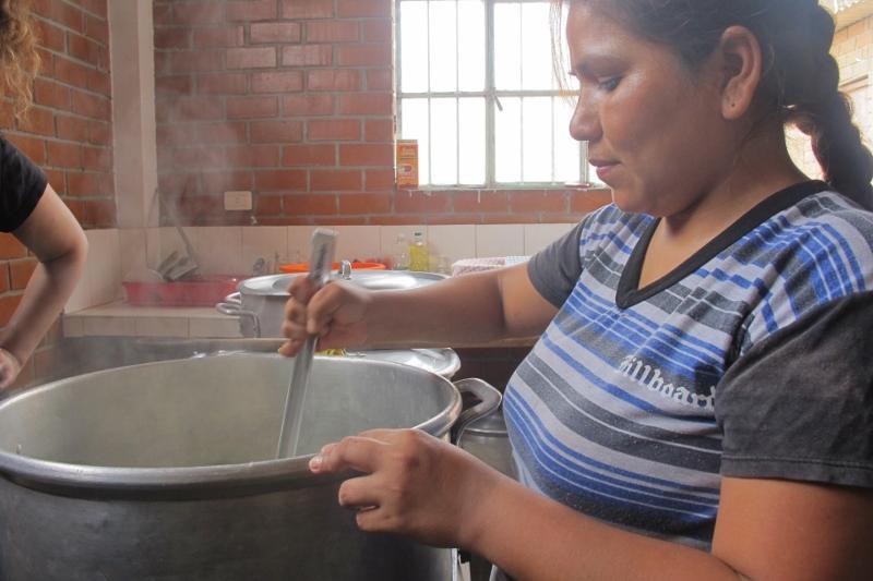 Elisabeth preparing a meal