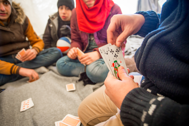 Refugees play games to pass the time