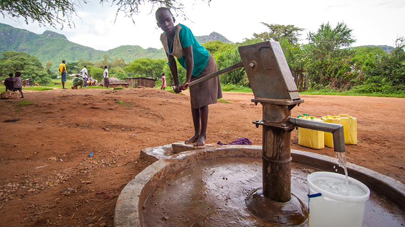 Proscovia in Uganda at water pump