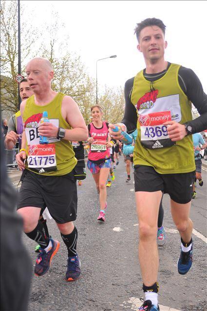 Ben (left) running with fellow volunteer Alistair Thornton, in the 2016 London Marathon