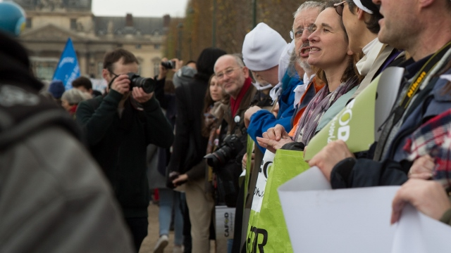 Liam taking photos of CAFOD supporters calling for climate change action in Paris (Judith Tooth)