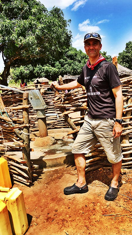 Justin visiting one of CAFOD's boreholes in Uganda