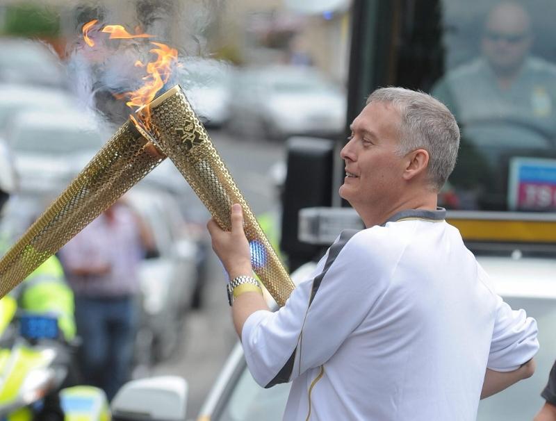 John McBride carrying the Olympic flame trough Barnard Castle