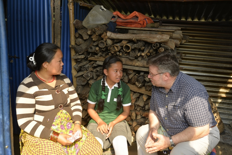 CAFOD Director Chris Bain listens as Kamala and Asmita share their story