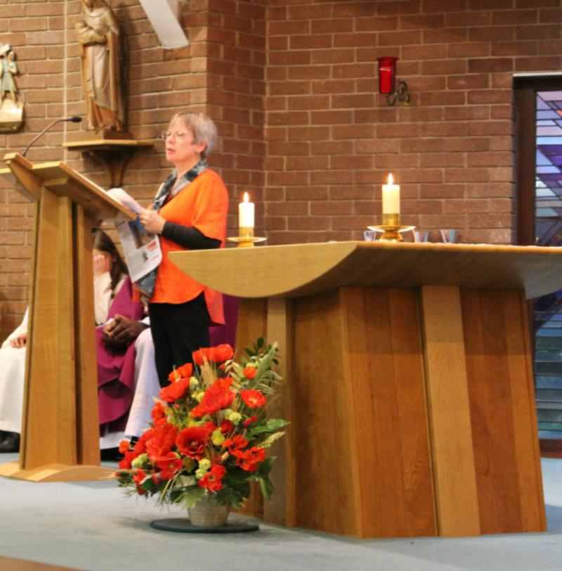 Education Volunteer Margret Wellington speaking at mass earlier this year