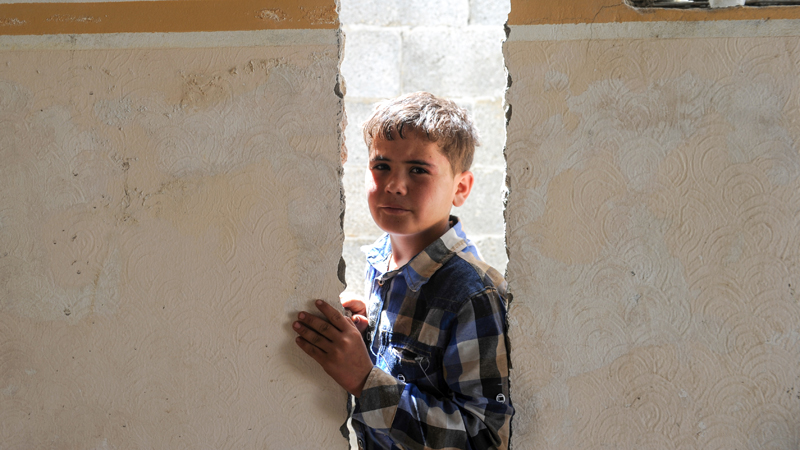 mohammed-standing-in-his-destroyed-home-gaza