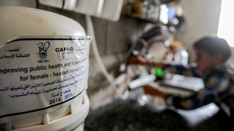 mohammed-using-a-water-filter-provided-by-cafod-in-gaza