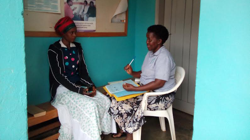 Nalwadda Nuluyati at a consultation with staff at CAFOD partner Kitovu Mobile in Uganda