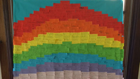 During the Harvest assembly, the school community created a bright rainbow showing their hopes for the world.