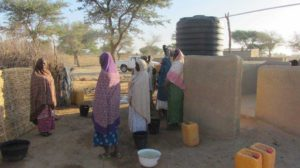 Women from our Hands On project collect water from the new borehole.