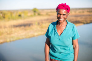 Florence near her fish pond CAFOD Lent
