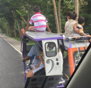 tuk tuks on a road in the Philippines
