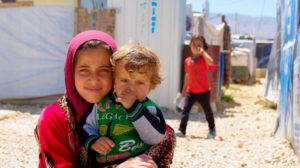 Syrian refugee children living in an informal camp in Lebanon