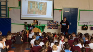 Education volunteer Margaret sharnig stories from El Salvador for Harvest Fast Day with children at St Bede's school