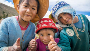 Rosa and Bernardo's children - thumbs up for their vegetable harvest in Bolivia