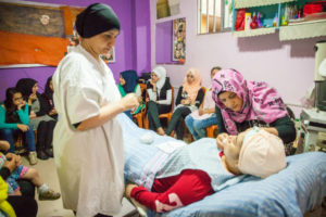 Refugee women learning about beauty treatments in Lebanon