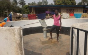 Alusine Sankoh at the borehole.