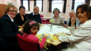 Holy Name parishioners holding a Family Fast Day lunch