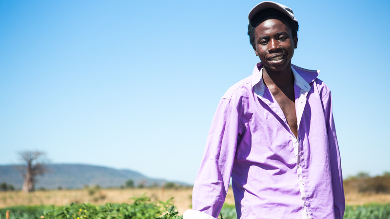 Tawanda by his vegetable garden in Zimbabwe