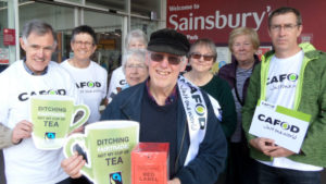 Vin Allerton (with the red box) with a group of CAFOD staff and volunteers. Campaigning in Salford telling Sainsbury's not to ditch Fairtrade.