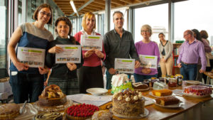 Staff members at the Romero House annual bake off competition