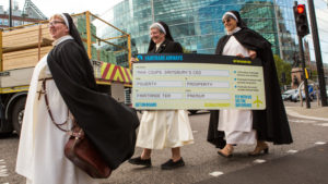 Sister Dominica, Sister Chris and Sister Karen took to the street to campaign for Fairtrade. They are carrying a giant boarding pass to hand over to Sainsbury's CEO Mike Coupe, to encourage him to visit Fair Trade farmers overseas and not ditch the Fairtrade label on Sainsbury's tea.
