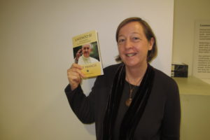 Susy Brouard holding a copy of the Laudato Si