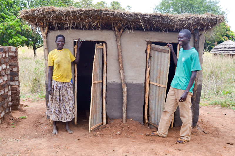 Monica and Samuel outside their new toilets.
