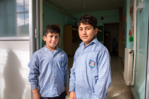 Mostafa and Hussein all dressed up for school.