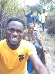 Oge Chukwudozie, CAFOD's Humanitarian Capacity Strengthening Officer (second in the photo) travelling by canoe during the recent floods in Kogi state.