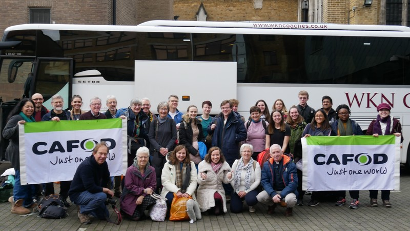 CAFOD staff and volunteers outside their coach on the way to COP24