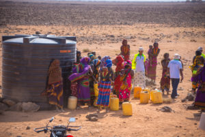 Community members collecting water from the water tank in Northern Kenya.