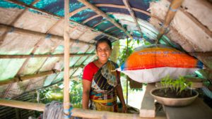 Eshita stands proudly in her greenhouse where she stores her compost