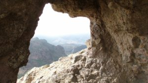 Looking out from the mouth of a cave at the mountains., giving the impression of the empty tomb.
