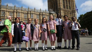 Children standing outside Parliament during the Time is Now mass lobby
