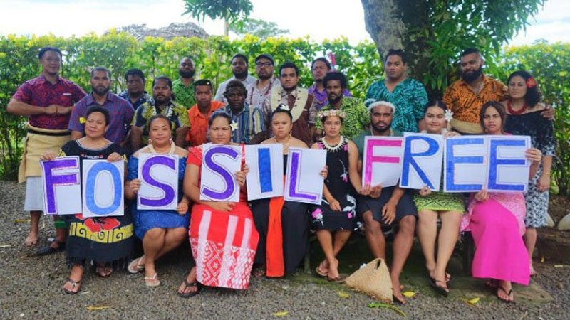Auimatagi - in the centre with glasses - and the Pacific Climate Warriors are sending their message for the Fossil Free Campaign.