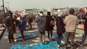 Climate change protesters on a bridge in London