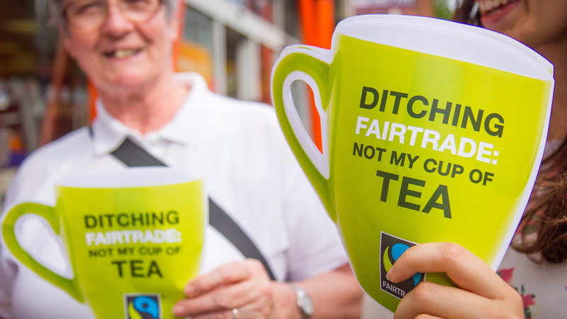 CAFOD campaigners protesting against Sainsbury's decision to drop Fairtrade from certain of its own-brand teas.