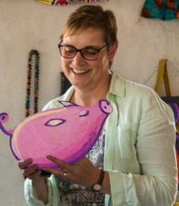 Christine Allen with the Pig that Provides from World Gifts