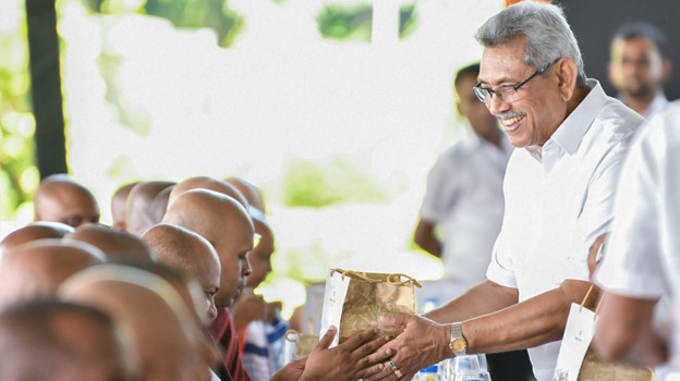 President Gotabaya Rajapaksa offering alms to Buddhist monks