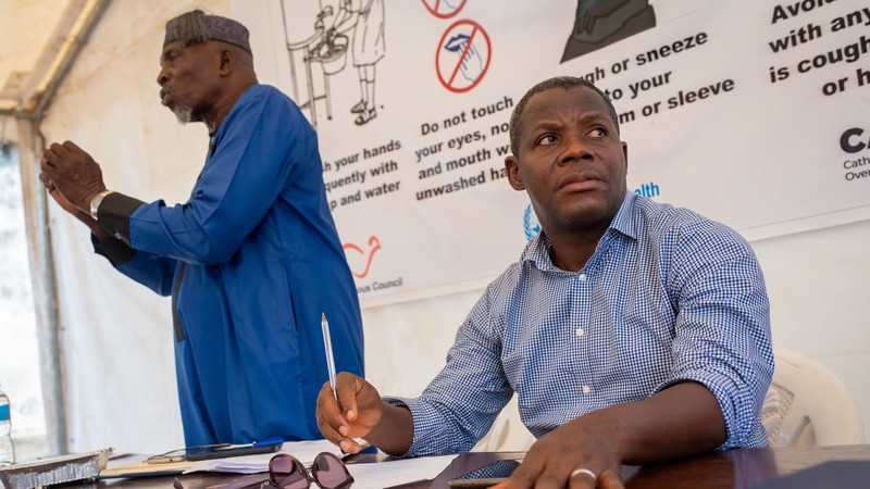Kayode Akintola (right) during a COVID-19 awareness training for religious leaders at CAFOD's office in Freetown