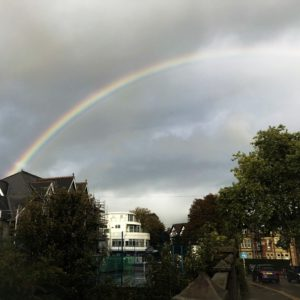 A rainbow in a cloudy sky